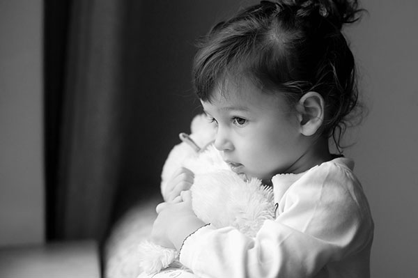 Child holding teddy bear CPS Family Law