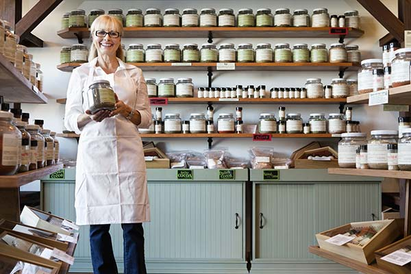 Woman holding jar, small business